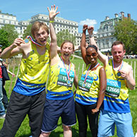 Four fundraisers celebrate finishing a race