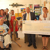 A cheque is presented to fund an accessible easel