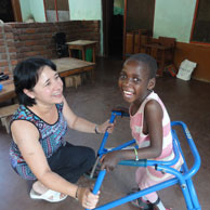 A young girl in Malawi uses a walking frame supplied through our recycling initiative