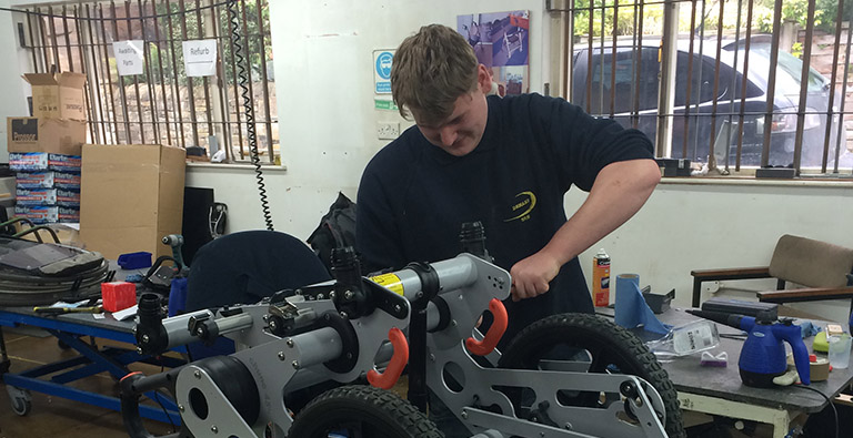 A DEMAND engineer carrying out a service on a Chunc wheelchair