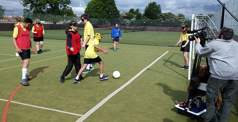 Students at Bushey Meads School are filmed playing audible football