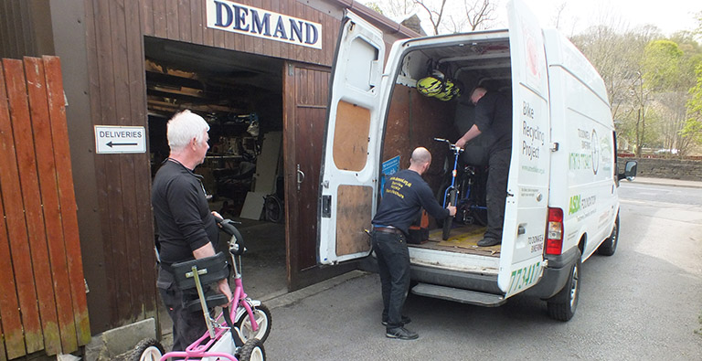 Dave from Streetbikes collects the refurbished bikes from DEMAND's workshop