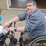 Richard and his daughter Isabel testing their new wheelchair accessible buggy