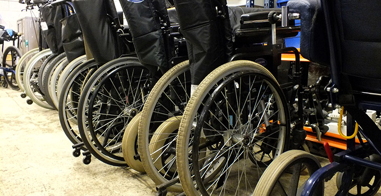 Used wheelchairs stored in DEMAND's workshop