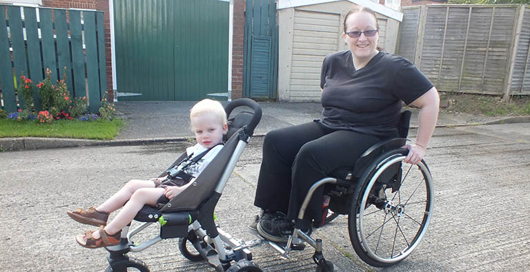Cheryl and her son test the buggy attachment