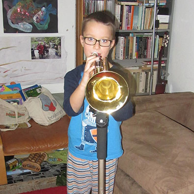 Samuel playing the trumpet
