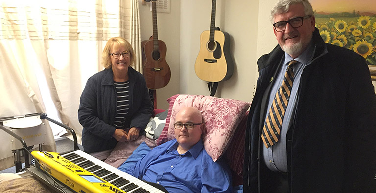 JJ and two donors from the Coalville Rotary Club with the new keyboard table