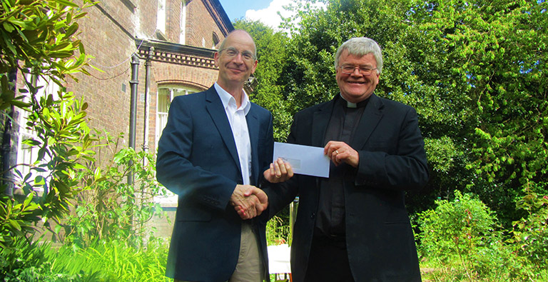 Cheque presentation at St Alban's Abbey