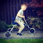 Brody using his custom push trike