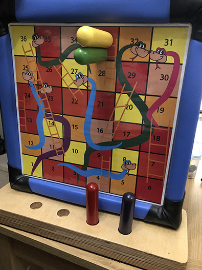Accessible snakes and ladders board