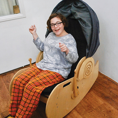 Person in Sensory Shell Chair