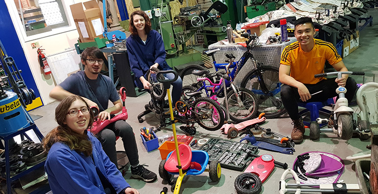 DEMAND team disassembling products in the workshop